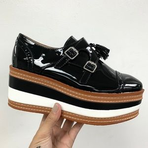 Black patent striped loafer